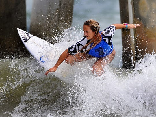 Storm Portman of Indialantic cuts back on a nice wave during her heat at the 30th annual NKF Surf Festival held at the Cocoa Beach Pier.