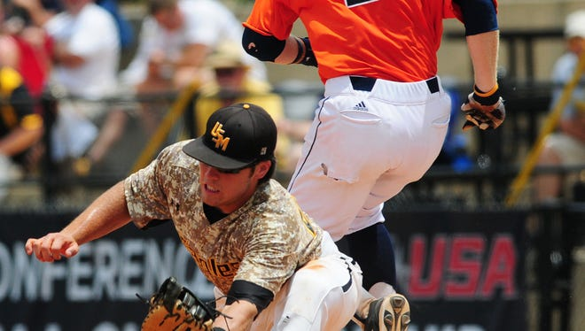 Southern Miss first baseman Dylan Burdeaux (24) fails to get the force-out on UTSA's C.J. Pickering (27) on the fourth day of the Conference USA baseball tournament.