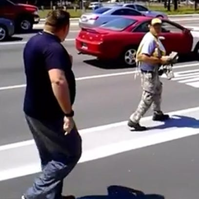 Army veteran Garrett Goodwin confronts a panhandler