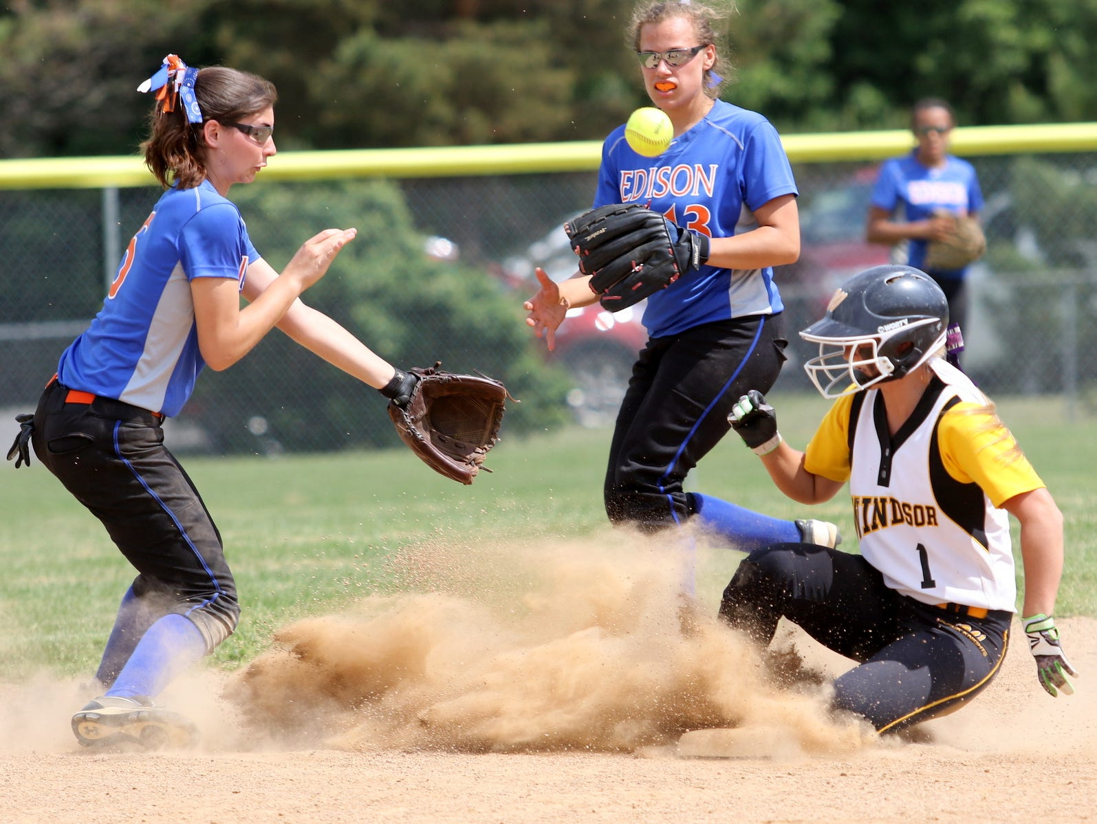 Windsor's Allison Lockwood slides safely into second as Edison's Haley Maggs awaits the ball during Saturday's Section 4 Class B softball final at BAGSAI Complex.