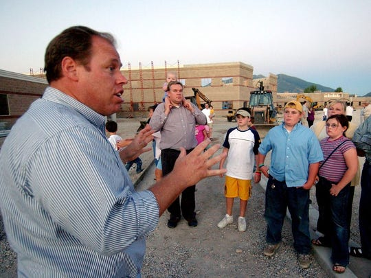 Glenn Way, a former Utah legislator, gives a tour of an American Leadership Academy campus in Spanish Fork, Utah, in 2005.