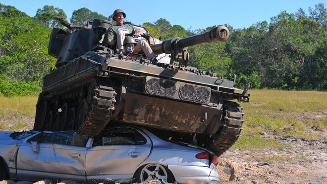 Tank America in Melbourne invited the media to tour its facility  recently, touring the realistic laser tag arena set up like southwest Asia and ride in a tank or personnel carrier. WKMG's James Sparvero drives a tank over a car.