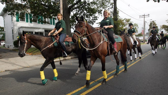 "Karen Evilsizor of Manalapan, right, and Leslie McLaren of Columbus, left, representing the Standardbred Pleasure Horse Organization of New Jersey ride in the ""Parade of Horses"" on West Main Street in Freehold Borough as part of the 2012 Open Space Pace event at Freehold Raceway."