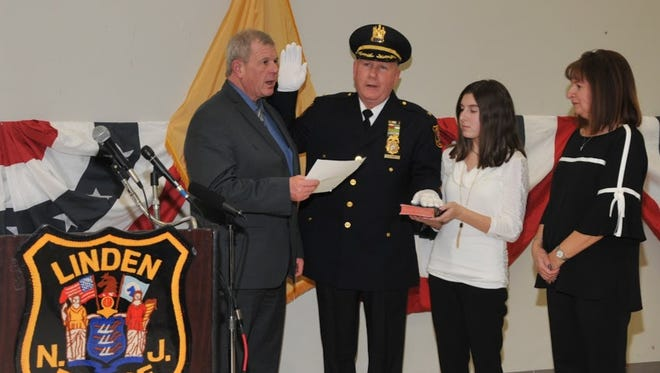 David Hart is sworn in Wednesday as Linden's police chief. Standing with Hart are Linden City Clerk Joseph Bodek and Hart's daughter Mia and wife, Tina.