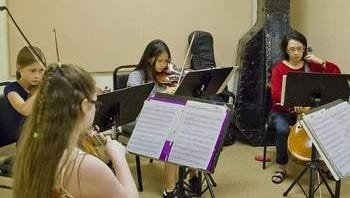 A candid photo of a string quartet from the 2013 Chamber Music Workshop.
