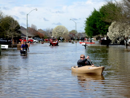 Golden Meadows resident Sabrina Langley canoes to the
