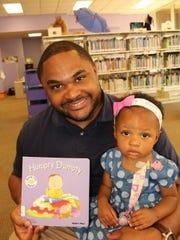Robert Douglass and his year-old daughter Arabella