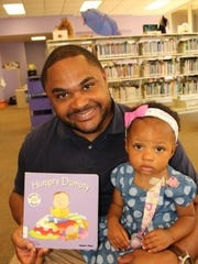 Robert Douglass and his year-old daughter Arabella had fun at the Dads and Daughters Saturday event at the Juliette Hampton Morgan Memorial Library.