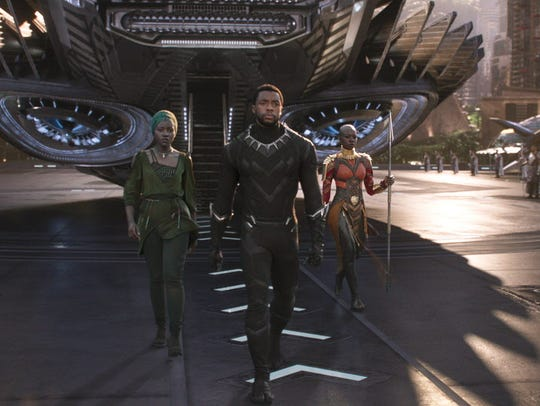 T'Challa/Black Panther (Chadwick Boseman) is supported