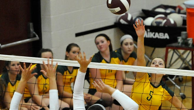 Michaela Bissinger (5) and Reynolds will be home for the start of the NCHSAA 3-A volleyball playoffs.