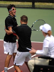 Crowell's Skyler Hayes (left) celebrates with partner