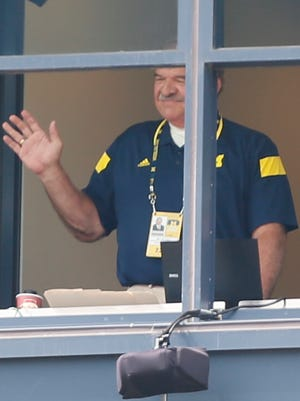 Michigan radio announcer Dan Dierdorf waves from his booth as he is introduced in the first half of the Appalachian State football game in Ann Arbor on Aug. 30, 2014.