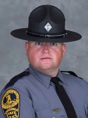 This undated photo provided by the Virginia State Police shows Trooper-Pilot Berke M.M. Bates of Quinton, Va.