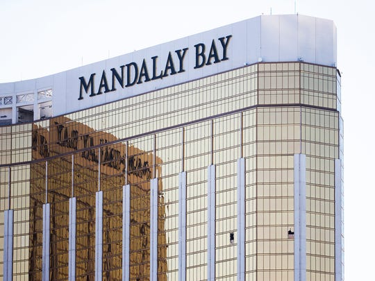 The two windows that gunman Stephen Paddock shot through, killing 58 people attending the Route 91 Harvest country music festival, can still be seen at Mandalay Bay, Wednesday,morning, October 4, 2017.
