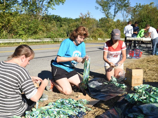 Volunteers unpack medals to be handed out to the half-marathon