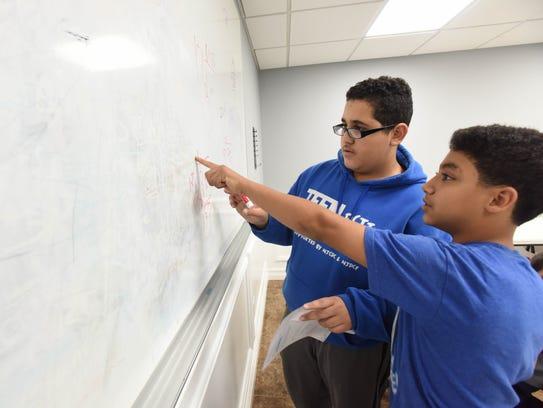 Abdalla Yousef and Mustafa Radwan doing homework at