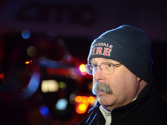 Urbandale Fire Chief Jerry Holt speaks with reporters