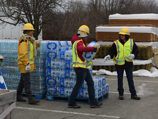 Central Hudson workers gave out dry ice and water to
