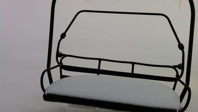 Snow on a Heavenly Mountain Resort ski lift chair following a 2012 storm.