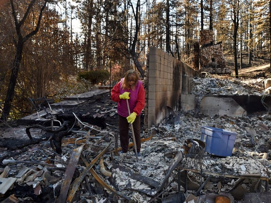 Debbie Sheltra sorts through the rubble that is left of her home on Franktown Road after the Little Valley Fire completely destroyed her house and everything in it.