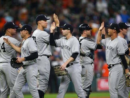 New York Yankees players celebrate after defeating