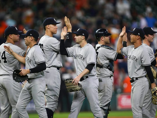 New York Yankees players celebrate after defeating the Houston Astros at Minute Maid Park on Friday, June 30, 2017.