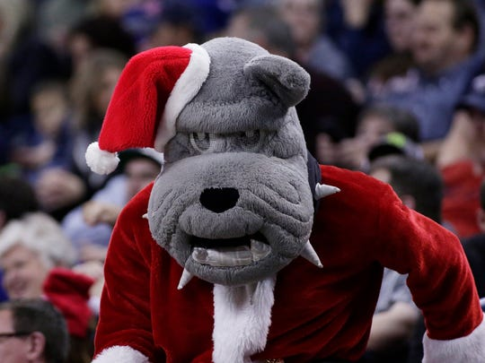 The Gonzaga mascot walks in the stands during the second half of an NCAA college basketball game between Gonzaga and South Dakota in Spokane, Wash., Wednesday, Dec. 21, 2016. (AP Photo/Young Kwak)