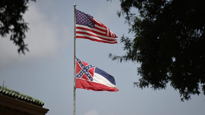 The American flag and the Mississippi State flag fly in downtown Jackson.