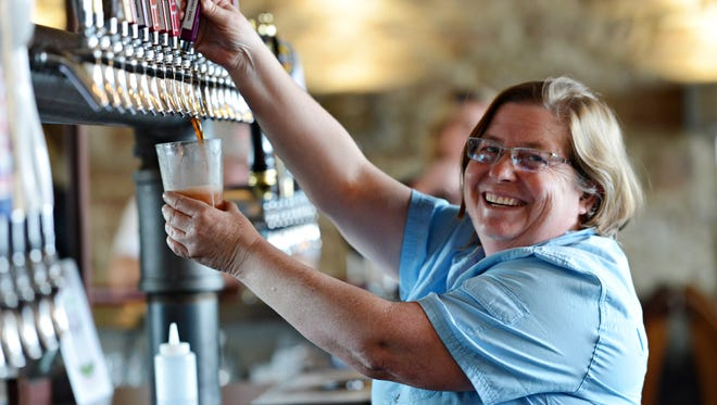 Owner Jennifer Seiwald pours a Strawberry Basil cider at Scrumpy's on Friday, April 21, 2017.