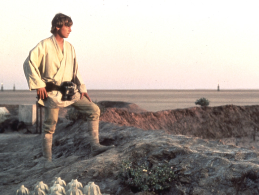 Luke Skywalker, played  stands at the edge of the crater