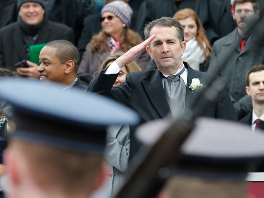 Gov. Ralph Northam salutes the Virginia Military Corp