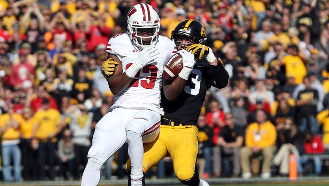 Badgers running back Dare Ogunbowale caught four passes for 51 yards against Iowa.