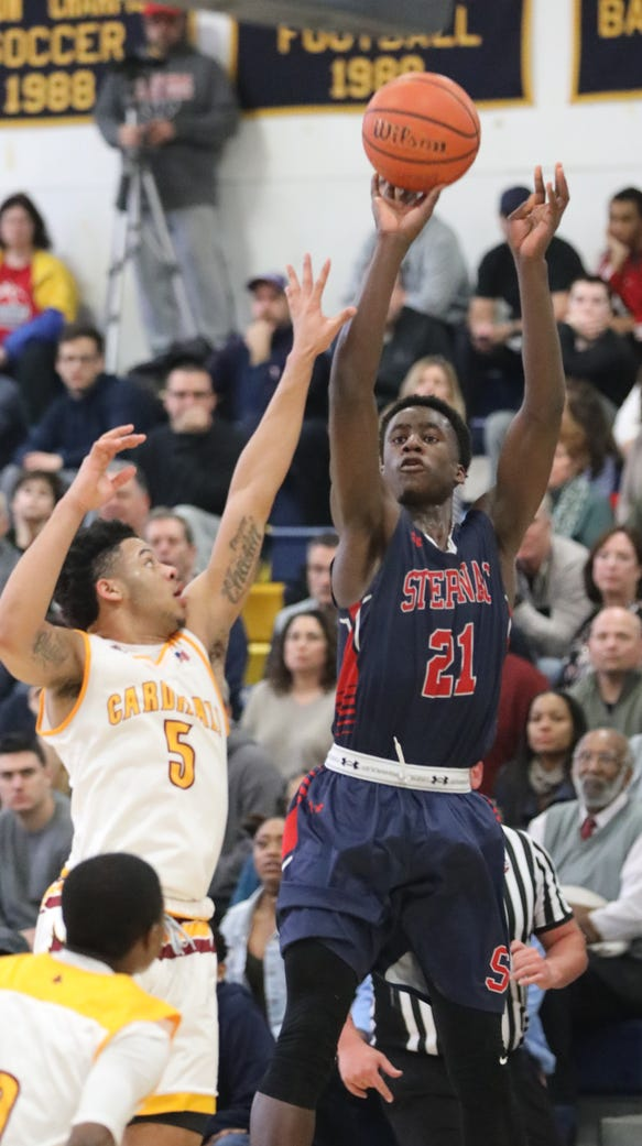 Archbishop Stepinac's Adrian Griffin Jr. shoots from