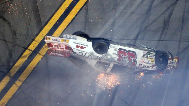 Justin Fontaine flips upside down following a multi-car crash in Saturday's ARCA race at Daytona International Speedway.