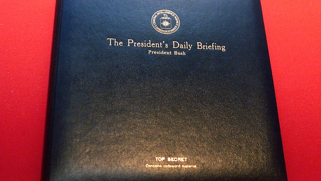 The President's Daily Briefing binder for President George W. Bush is displayed in this Feb. 15, 2002, file photo at the Ronald Reagan Presidential Library in Simi Valley, Calif.