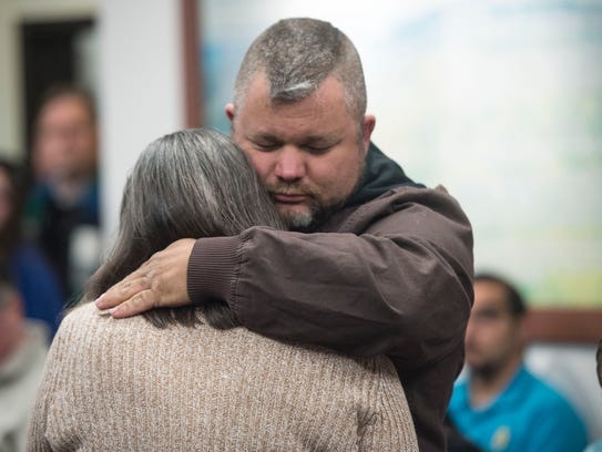 Melinda Stites is hugged by her husband Eric after