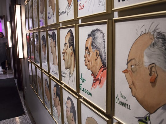 Caricatures from the history of baseball hung on the walls inside the Pink Pony.