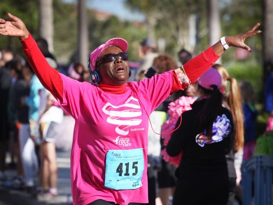 Cancer survivor Myrna Young, of Fort Myers, celebrates after finishing the Susan G. Komen Southwest Florida Race for the Cure at Coconut Point. Young has participated in the past but actually finished the race for the first time on Saturday. Jack Hardman/The News-Press Cancer survivor Myrna Young, of Fort Myers, celebrates after finishing the Susan G. Komen Southwest Florida Race for the Cure at Coconut Point. Young has participated in the past but actually finished the race for the first time on Saturday.