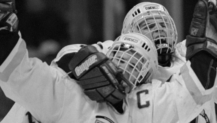 Vermont's Martin St. Louis, left, celebrates with teammates after scoring the winning goal against Lake Superior in their NCAA Division I East Regional game in Albany, N.Y. in 1996. Vermont won 2-1.