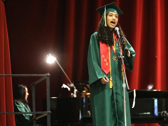 Brittany Alexander sings the National Anthem accompanied by Dahlia Notis on piano, as Lakeland High School held their commencement exercises at the Westchester County Center in White Plains, June 23, 2018.