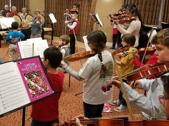 Centenary Suzuki School students perform outreach concerts
