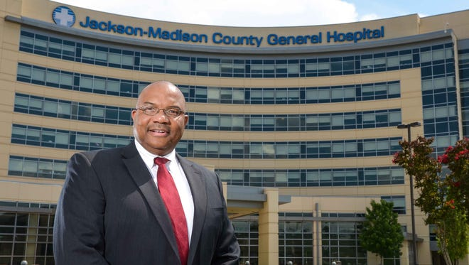 West Tennessee Healthcare CEO James Ross stands in front of the entrance to Jackson-Madison County General Hospital.