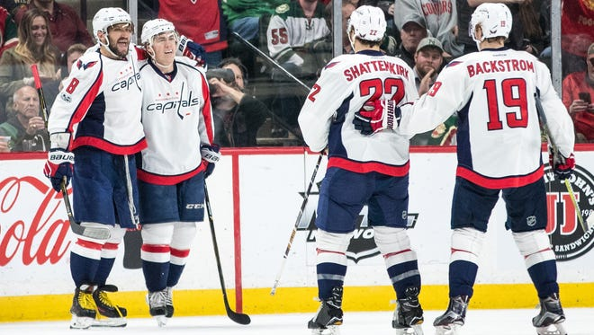 Capitals forward Alex Ovechkin, left, celebrates with teammates after scoring one of his three goals against the Wild at Xcel Energy Center in St. Paul.