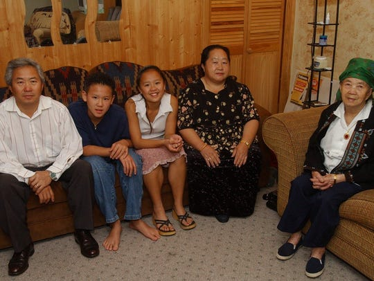 Tong Xeng Thao's family, seen in 2002, was the first