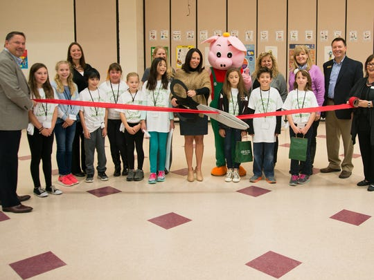 Huron Valley State Bank and Heritage Elementary School recently cut the ribbon on an HSVB branch at the school.