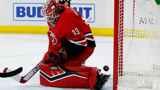 Carolina Hurricanes goaltender Scott Darling has the puck slip past for a goal by the Columbus Blue Jackets.