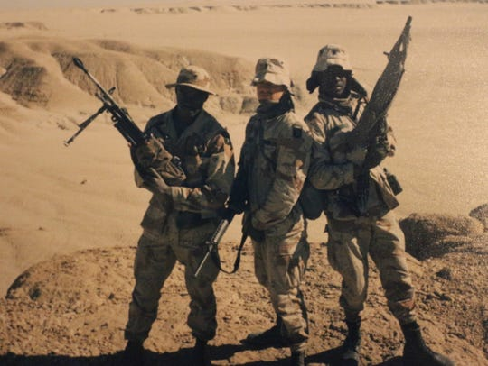 Glen Coleman, left, stands with other soldiers of his