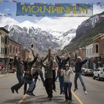 "Members of the ""Unbranded"" team jump for joy after learning the documentary was chosen as the audience choice award at the 2015 Telluride Mountainfilm Festival. Members of the team include, from left: Will Lake Springstead, Scott Chestnut, Korey Kaczmarek, Ben Masters, Dennis Aig, Paul Quigley, unidentified, Kristyn Birrell and Phillip Baribeau. Nearly all members of the production team are linked to MSU."