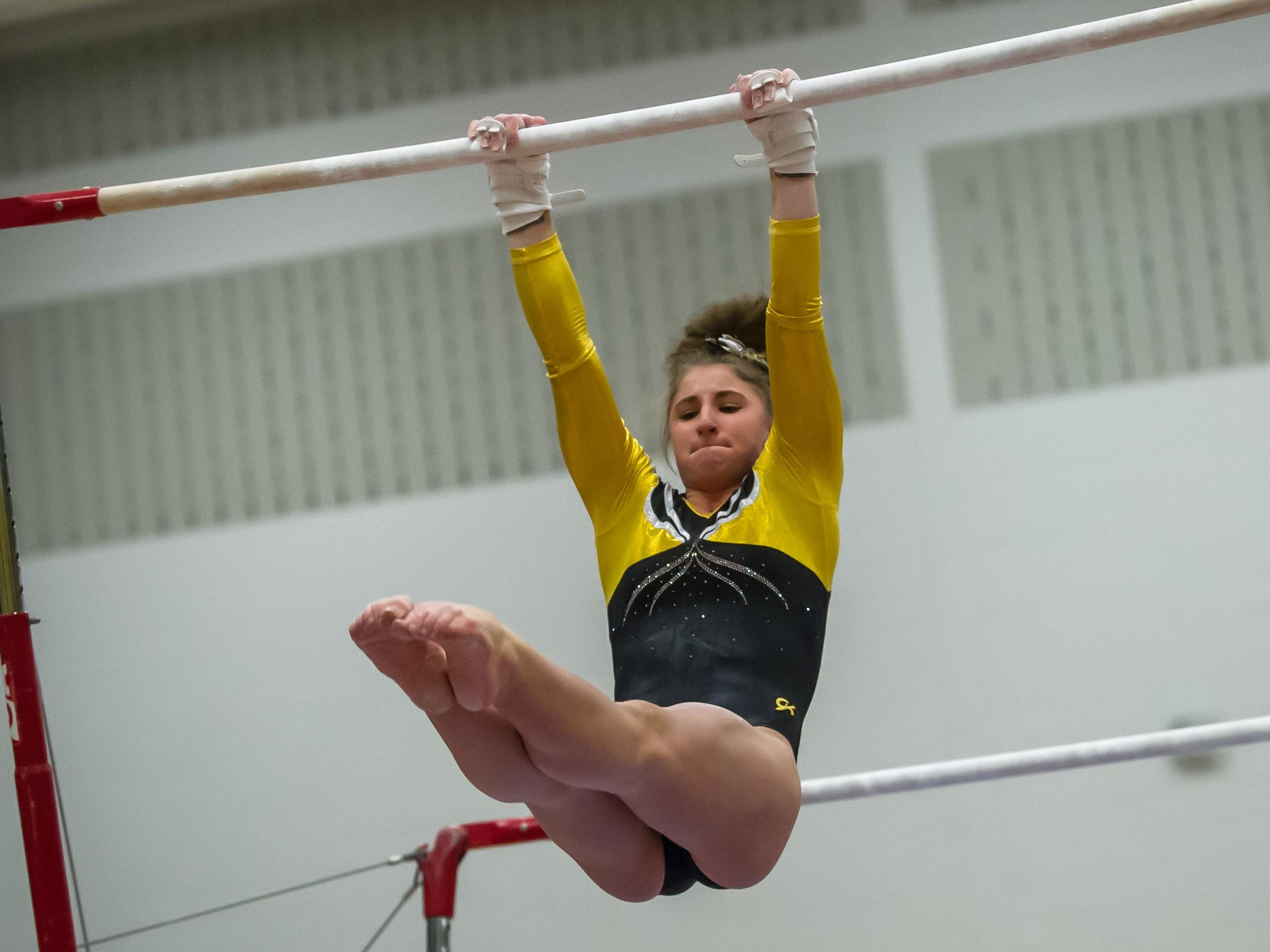St. John Vianney's Kristen Politz competes on the bars in the NJSIAA Gymnastics state individual championship at Montgomery High School on Saturday Nov. 14, 2015. Photo by Jeff Granit