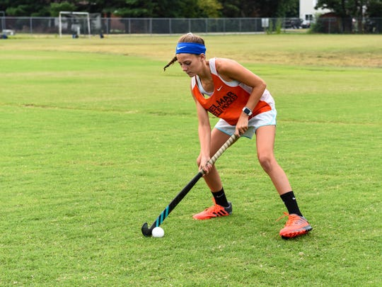 Maci Bradford, upcoming eighth grader at Delmar middle school, passes with a field hockey teammate on Monday July 16.
